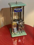 Norris Master 1¢ Penny Gumball Machine. Green And Tan Porcelain. Circa 1923