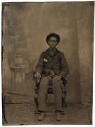 An Antique African American Tin Type Of A Young Man