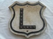 Shield-wood-road Street Sign Alphabet Letter L With Cat Eyes
