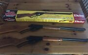 Two Daisy Red Ryder Bb Guns , Bbs And One Box