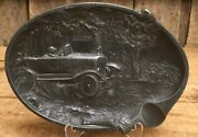 Vintage Early Embossed Pot Metal Tobacco Ashtray W Cool Antique Car Graphic