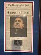 The Actual Newspaper Sealed And Put N A Frame.