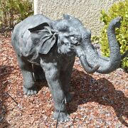 Dark Metal Cast Bronze Patina Sculpture Of An Elephant With Large Tusks Trunk Up