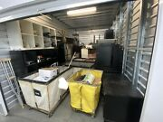 Storage Unit Auction - Desks Speakers Stove File And Wood Cabinets Monitors