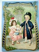 Very Large Die Cut W/ Picture Of Girl Holding Doll W/ Broken Leg And Boy Doctor