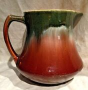 MELLOW ROSEVILLE GREEN DRIP TO BROWN GLAZE YELLOWARE PITCHER