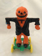 Vintage Halloween Plastic Scarecrow Black Jacket Candy Container On Wheels