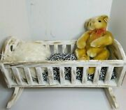 Custom Designed Wooden Rocking Crib With Antique White And Gold Finish.