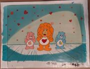 The Care Bears Opc Baby Hugs, Brave Heart Lion, And Bugs Tugs Original Cel