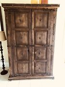 Armoire Made From Vintage And Antique Doors From Mexico With Handmade Iron Work