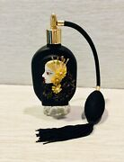 An Irice I. W. Rice And Co. Inc. Black Perfume Bottle W/ Atomizer Flapper.