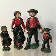 Vintage Cast Iron Amish Family Of 4 In Black And Red Figures