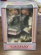 Cathay Collection Boy And Girl Porcelain Dolls On Wooden Swing