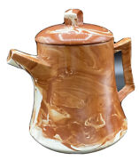 """Teapot Made From Alaskan Clay 7"""" X 7"""" Terra Cotta Color With Swirling Cream"""
