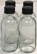 Used Set Of 4 Clear 2 Oz Glass Bottles With Black Lids Round Empty Free Ship
