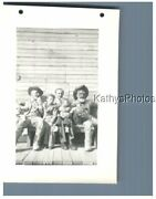 Found Bandw Photo H_7457 Man And 2 Boys On Bench Between 2 Cowboy Statues Kbf