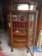 Antique Oak Curved Glass China Cabinet With Lionsheads