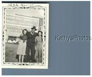 Found Bandw Photo G_2253 A Man And 2 Women Standing Western Auto Supply Co Sign