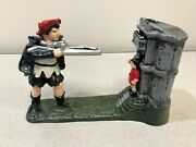 Bits And Pieces Cast Iron Mechanical William Tell Shooting Apple Bank