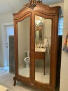 Antique French Armoire With Mirrored Doors And Hand-painted Custom Details