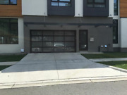 Full View [16'x7'] Black Anodized Aluminum And Tempered Frosted Glass Garage Door