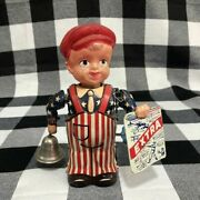 Vintage Celluloid Occupied Japan Tin Wind Up Paper Boy Toy Rings Bell Newspaper