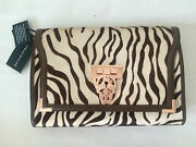Thomas Wylde Pony Hair Animal Print Clutch With Rose Gold Tone Scull Closure.