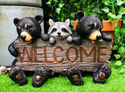 Rustic Bears And Raccoon Statue Holding An Outdoor Faux Wood Welcome Sign In ...
