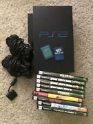 Sony Playstation 2 With Network Adapter, Memory Cards And 9 Games