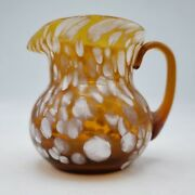 Miniature Hand Blown Glass Pitcher With White Spots On Brown Background 3