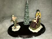 Dept 56 Man Pushing Woman In A Sled, Little Boy Running, And A Xmas Tree On Wood