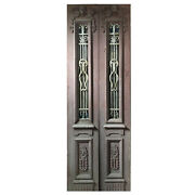 Salvaged Pair Of 34andrdquo Antique Figural Doors With Iron Inserts Ned1107