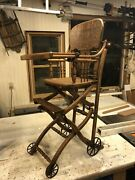 Antique Oak High Chair And Stroller Combination Chair.