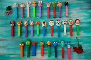 28 Vintage Collectible Candy Pez Dispensers With Feet