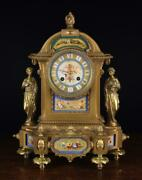 A Decorative 19th Century Mantel Clock With Porcelain Inset Plaques And Figural
