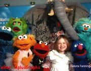 Dakota Fanning.. With Elmo And His Muppet Friends - Signed