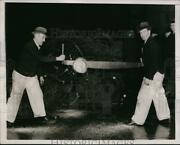 1937 Press Photo Sawing The End Of Christmas Tree To Set Flush - Ney00143