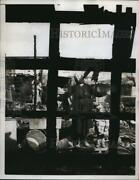 1958 Press Photo Mother Stands Amid The Ruins After A Fire Destroyed Dwellings