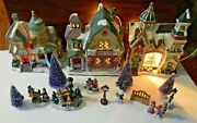 Christmas Village With Three Lighted Ceramic Buildings, Figurines And Trees