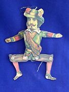 Antique German Tagged Meiul Lithographed Paper On Wood Jumping Jack Toy