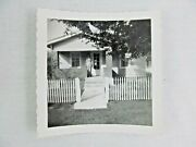 Vintage Black And White Snapshot Man On Porch Shadow Picket Fence Bandw Photograph