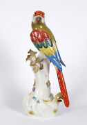 A Large Meissen Parrot Perched On A Treestump