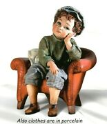 Statue Porcelain Figurine Baby Sitting On Armchair Made By Hand In Italy