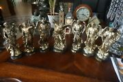 7 Brass Colored 8 Inch Tall Angel Statues W/ Brass Name Plate On Wooden Base.