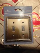Brand New Brainerd 64771 Double Switch Tumbled Antique Brass Wall Plate