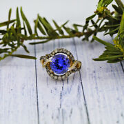 Fashion Cocktail Ring Features Main Blue Sapphire And Approx. 0.50ct Of Side Dia