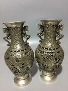 A Pair Old Tibet Silver Handwork Carved Dragon And Phoenix Hollow Vases