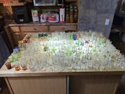 One Mans Lifetime Collection Of Shot Glasses