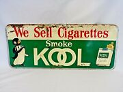 1950and039s Penguin Smoke Kool We Sell Cigarettes Tobacco Embossed Metal Sign 26x11