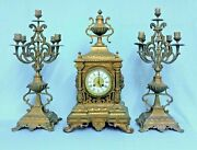 Antique French Brass Clock With Two Candle Holders.